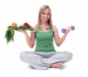 girl holding healthy foods and a dumbbell
